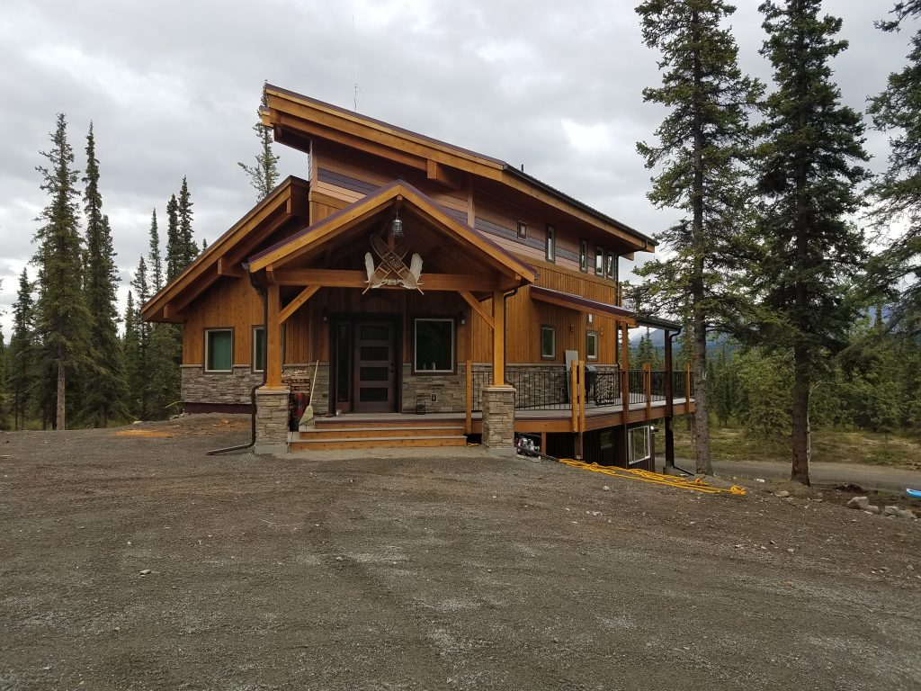 Wood stain colored siding on lodge style house