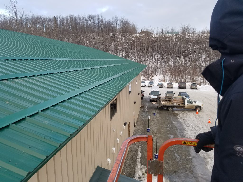 View from man lift next to roof