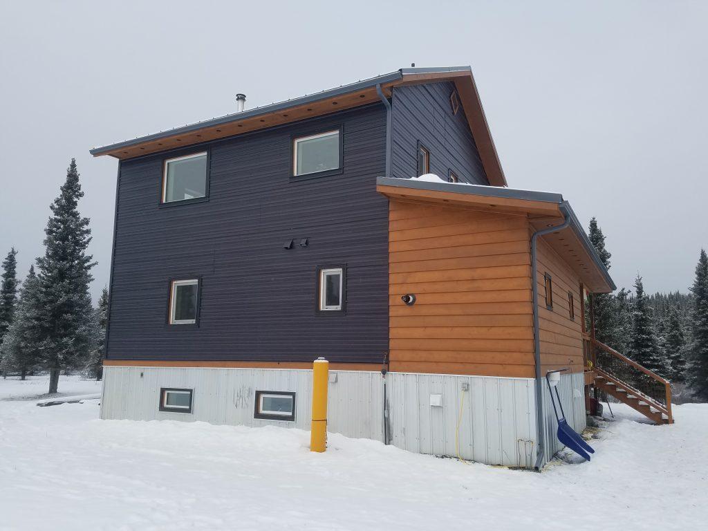 House with dark grey siding